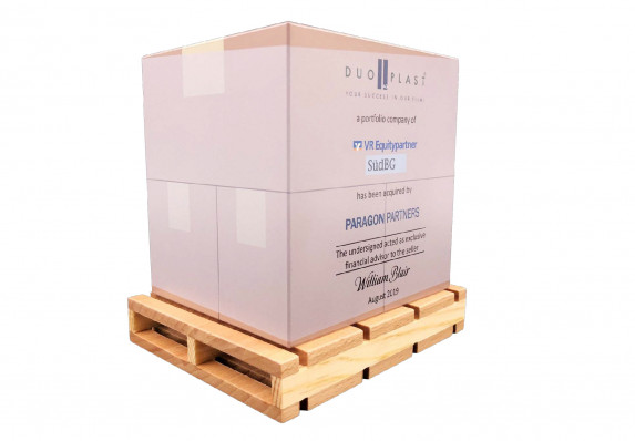 Acrylic block with financial transaction details is made to look like a stack of boxes, The form is presented on a model wood pallet
