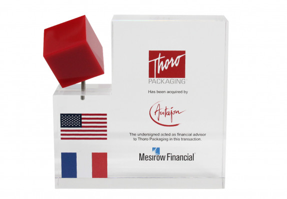 Clear acrylic financial tombstone with spinning red cube and full color logos presented at the close of an acquisition deal.