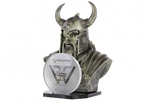 A bust of a viking is presented behind a round logo plaque in this deal gift for acquisition of a stream of precious metals.