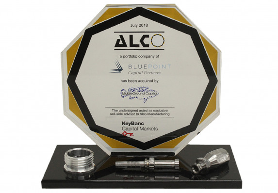 Color printed logo plaque is mounted on a black base with three model components for a sell-side acquisition deal toy.