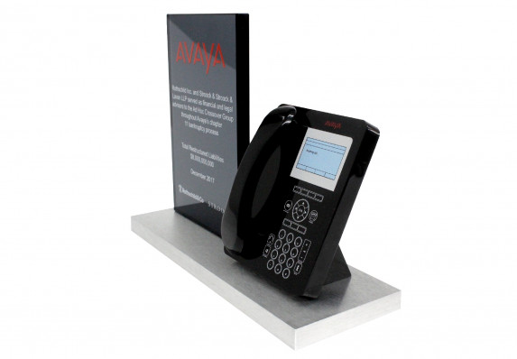 Highly detailed model of a business phone and a financial tombstone plaque mounted on a base for a bankruptcy deal.