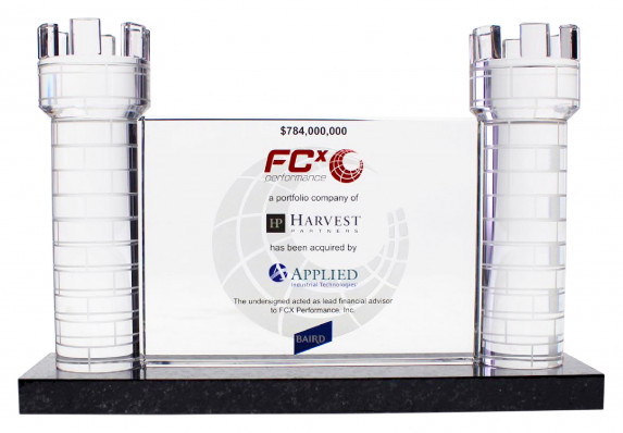 Acquisition deal gift with clear tombstone plaque between two etched crystal turrets.
