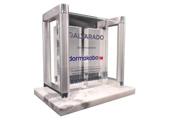 Metal, marble and crystal deal toy plaque created to commemorate a company acquisition transaction.