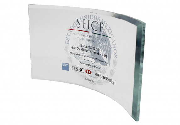 A curved glass panel deal gift with a beveled edge, reverse side etching and color printing. Commemorates a large international financial transaction.