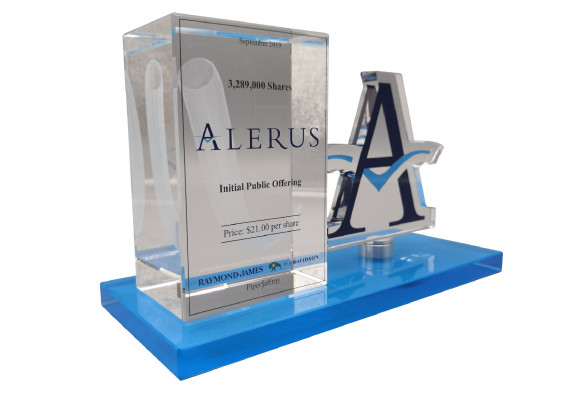 A Crystal Block Deal Gift for an Initial Public Offering Deal. The Tombstone Uses a 3-dimensional Etching Technique and Also Incorporates a Color-printed Cut-out Logo.
