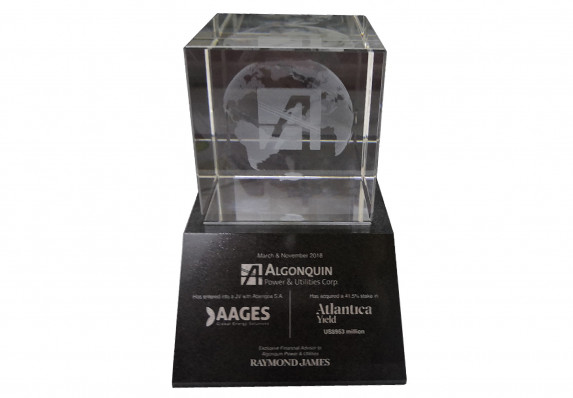 Clear crystal deal toy with 3d etched logo and globe on a tapered black tombstone base with colorfill text and logos.