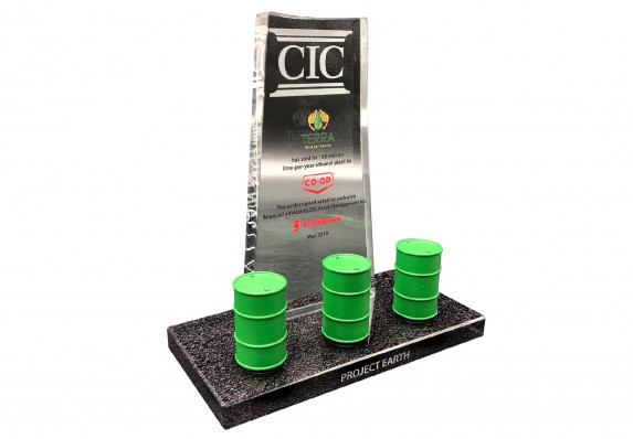 Model oil barrels are mounted on an etched logo marble base with crystal tombstone plaque in this luxury deal gift by Society Awards Finance Group.