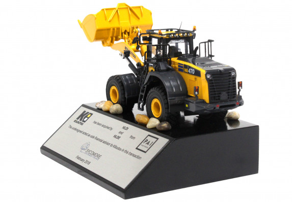 Financial advisor deal gift with a digger model mounted on a base with tombstone plaque.