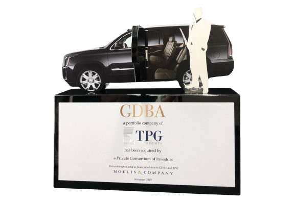 An Acquistion Deal by Investors is Commemorated in this Unique Luxury Tombstone with Color Printing, Large Logos, and Model Car.