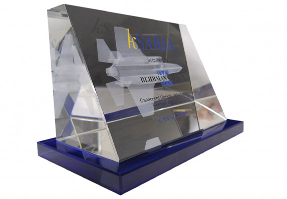 Tapered clear crystal deal toy is decorated with text and logos and a 3d etched fighter jet.
