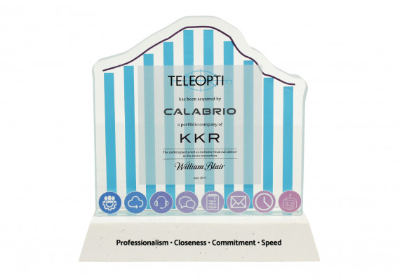A brand acquisition tombstone crafted with a custom-cut plaque, color printing and colorfilled base.