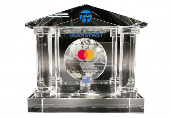 A crystal financial tombstone for the acquisition of a payment processing service by a major financial institution. The design has classic architectural style