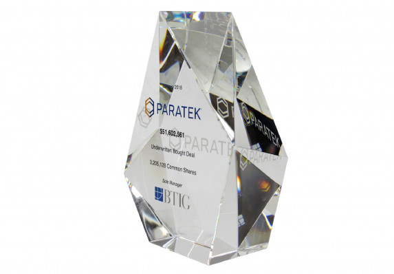 A prismatic standing deal gift with reverse etching and color logos and tombstone text.