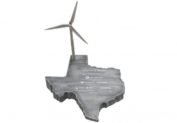 Metal deal gift in the shape of the state of Texas with a wind powered generator detail.